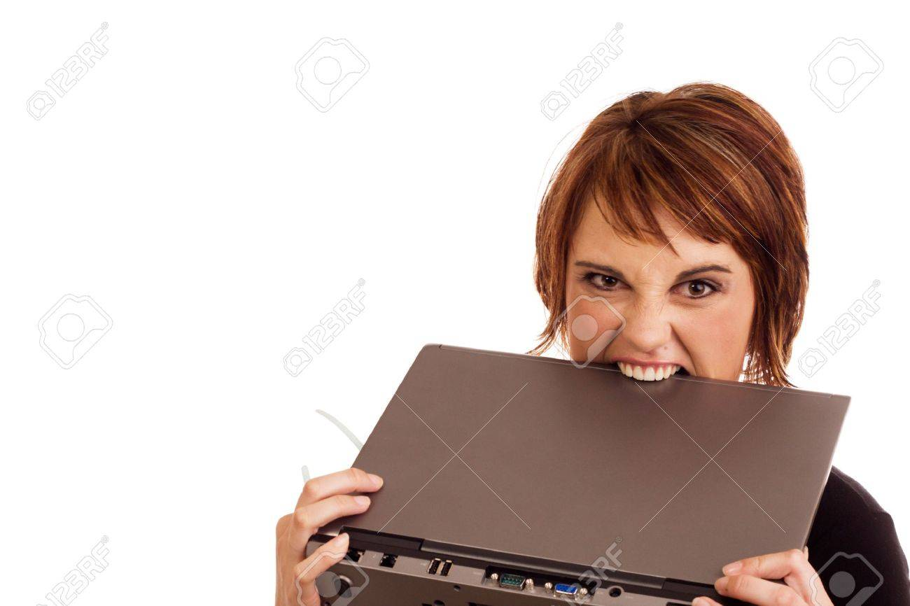 Frustrated Caucasian business woman holding her glasses and biting laptop in anger Stock Photo - 4167214
