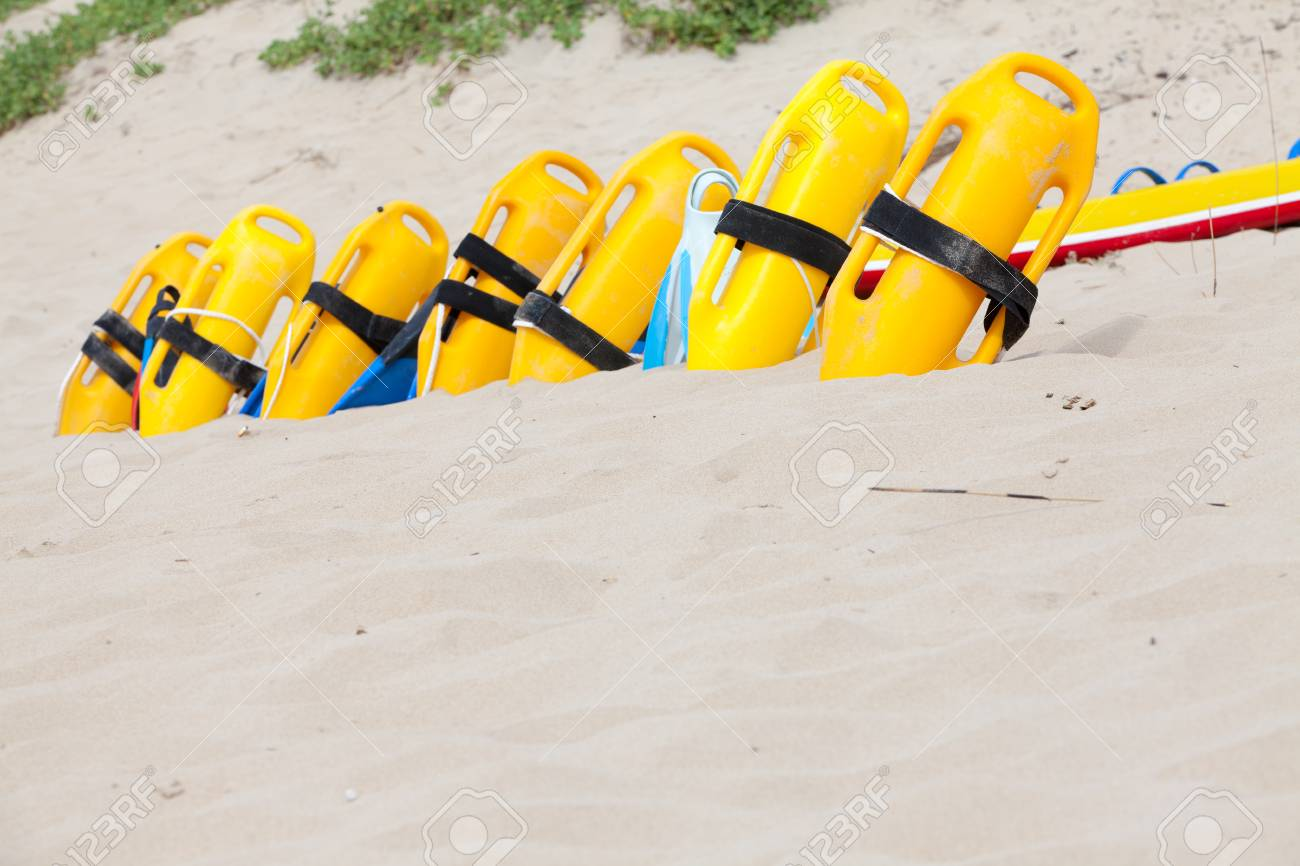 952304c2ad4 Row of lifesaving floatation devices on the beach Stock Photo - 52867403