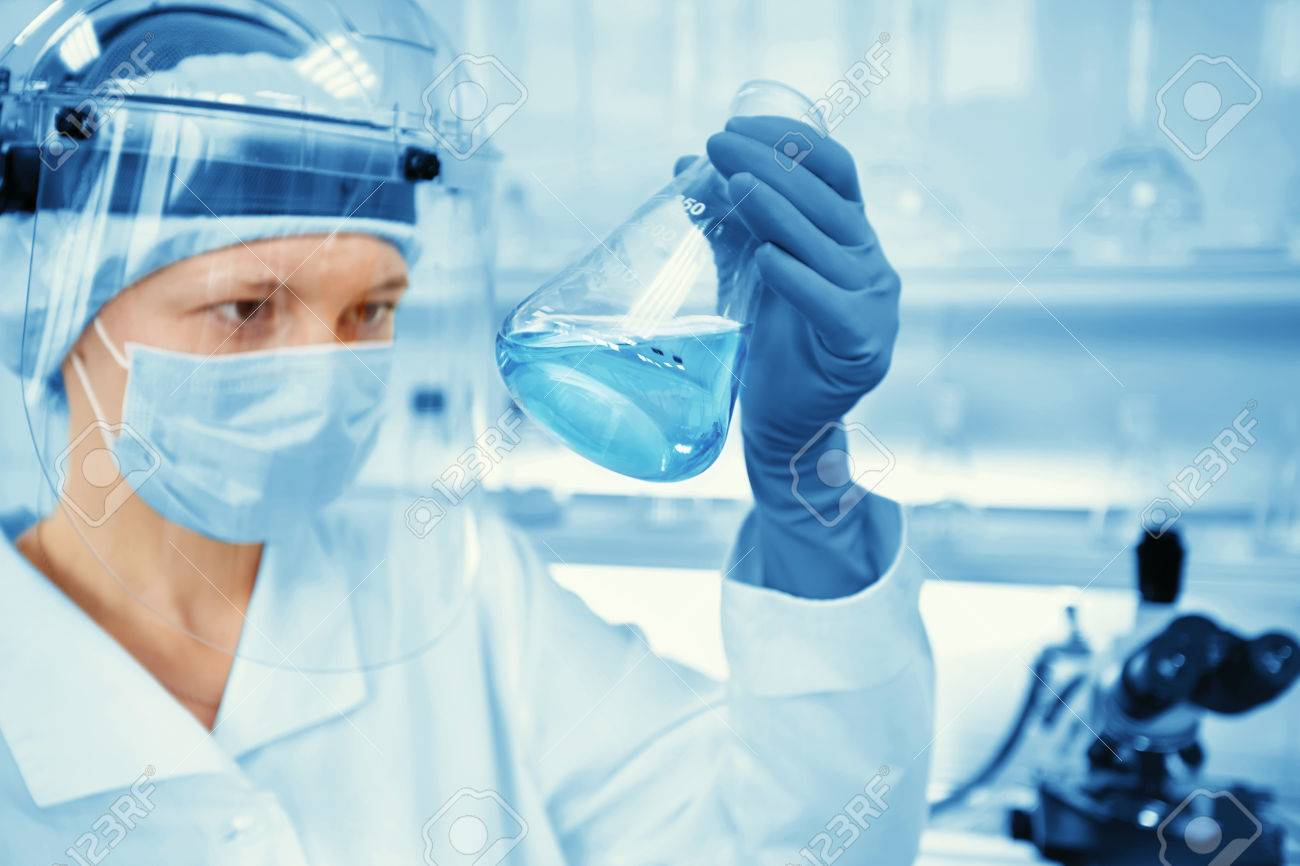 Closeup portrait female scientist holding conical tube with liquid solution, laboratory experiments, isolated lab background. Forensics, genetics, microbiology, biochemistry - 50556213