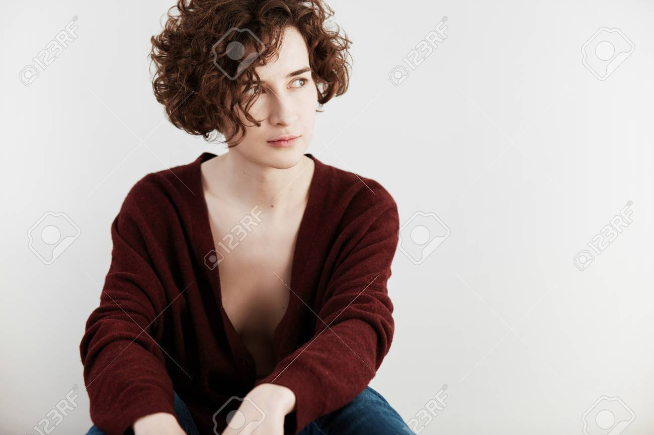 Portrait Of Caucasian Female With Short Curly Hair Cut Wearing