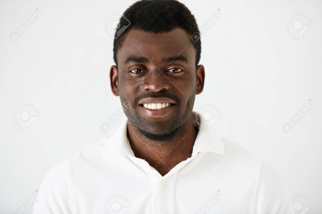 e6cd82b0e Headshot portrait of handsome young African American man with a beard  wearing white blank T-