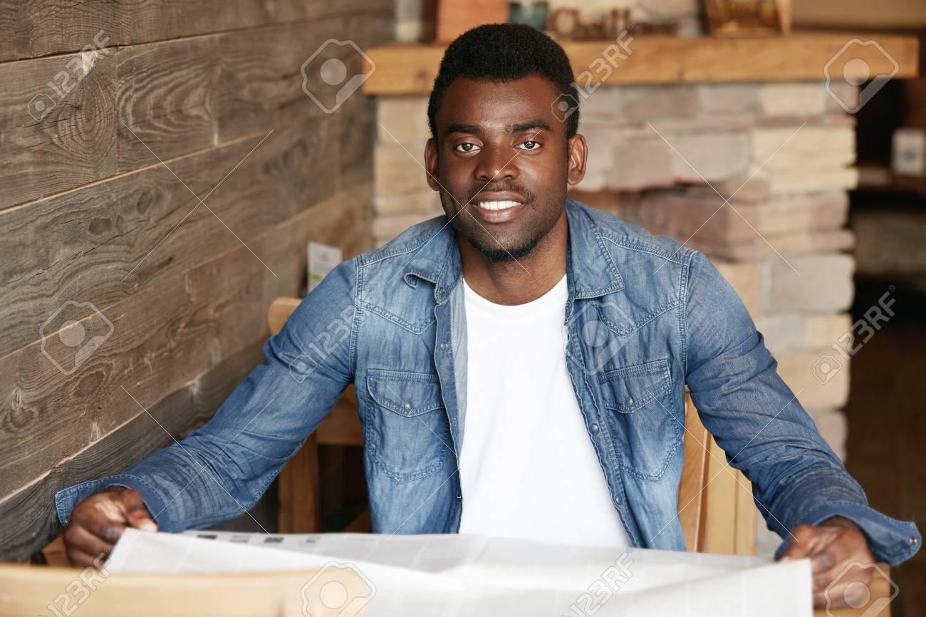 Handsome Black Man In Denim Jacket Over White T Shirt Looking