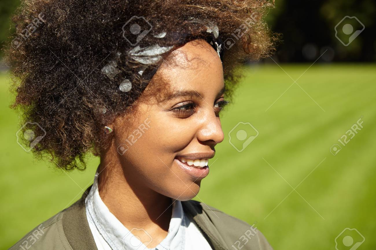 Profile Of Good Looking Dark Skinned Student Girl With Clean Stock