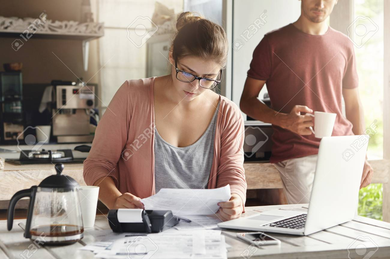 family budget and finances young woman doing accounts together