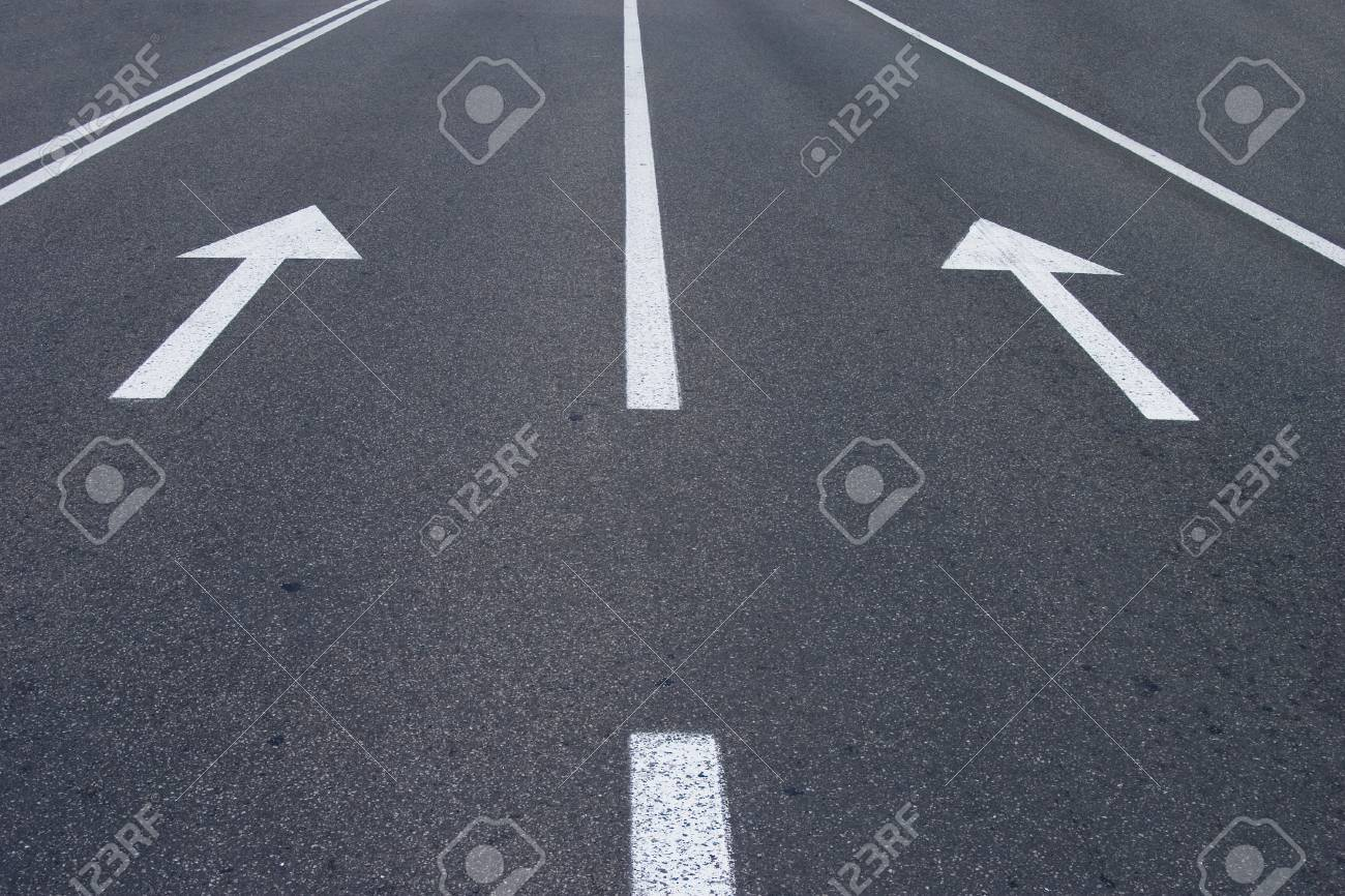 photo of road signs arrows on asphalted surface Stock Photo - 1367117