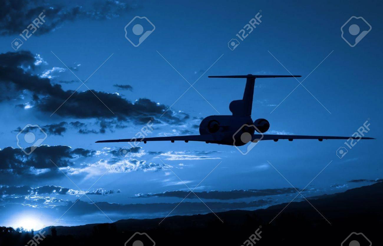 Aeroplane flying to sunrise Stock Photo - 2637294