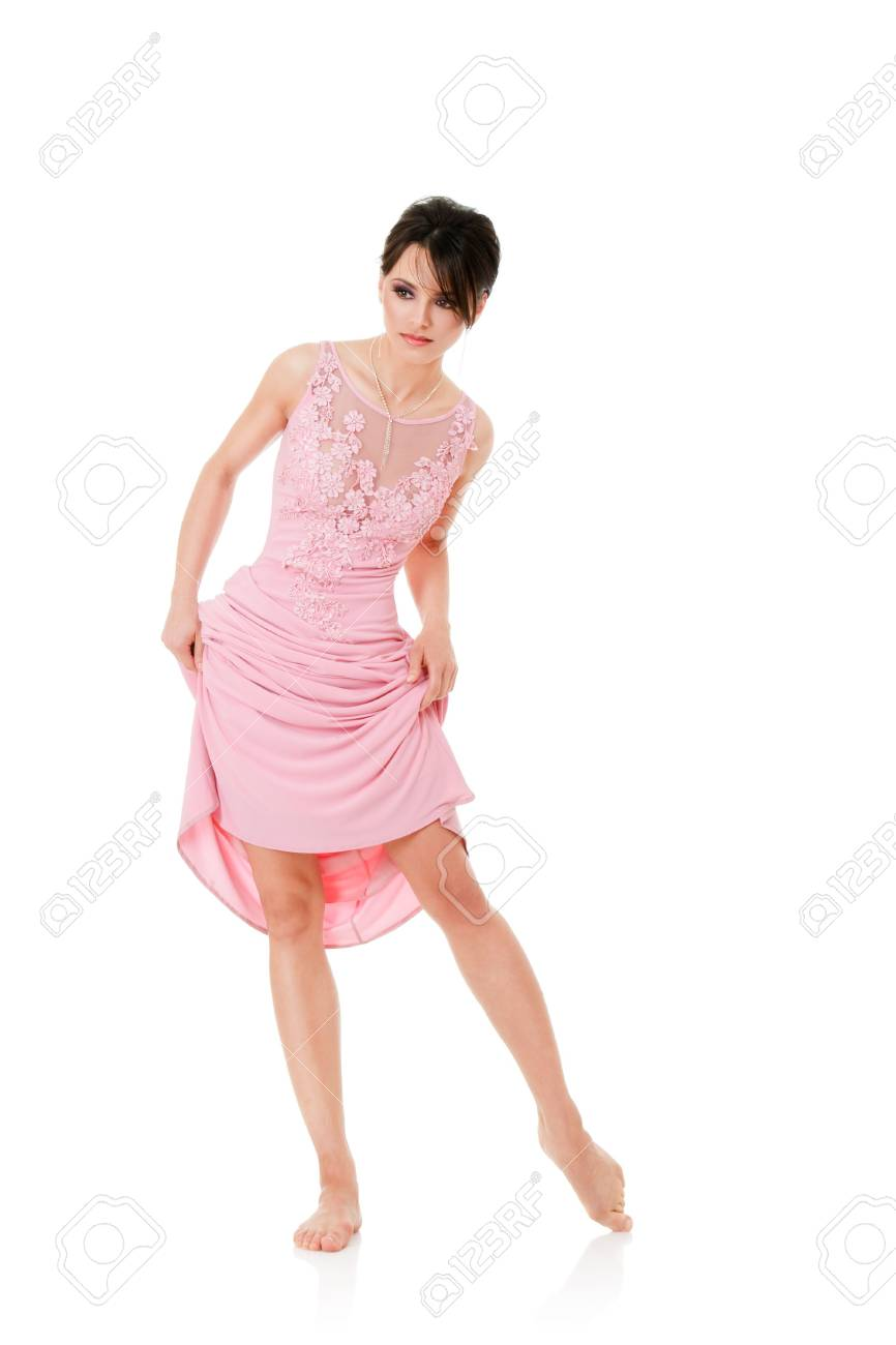 Beautiful woman in pink dress isolated on white background Stock Photo - 6681062