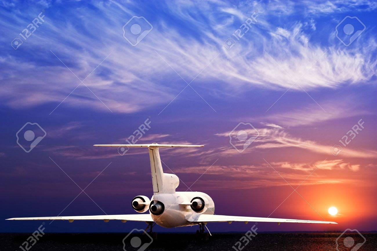 Passenger jet airliner on ground and stunning sunset Stock Photo - 8043472