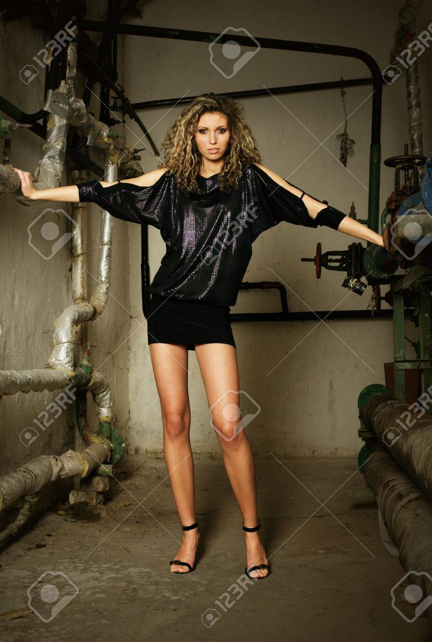 Fragile fashion model at dirty grunge water supply room Stock Photo - 8703304