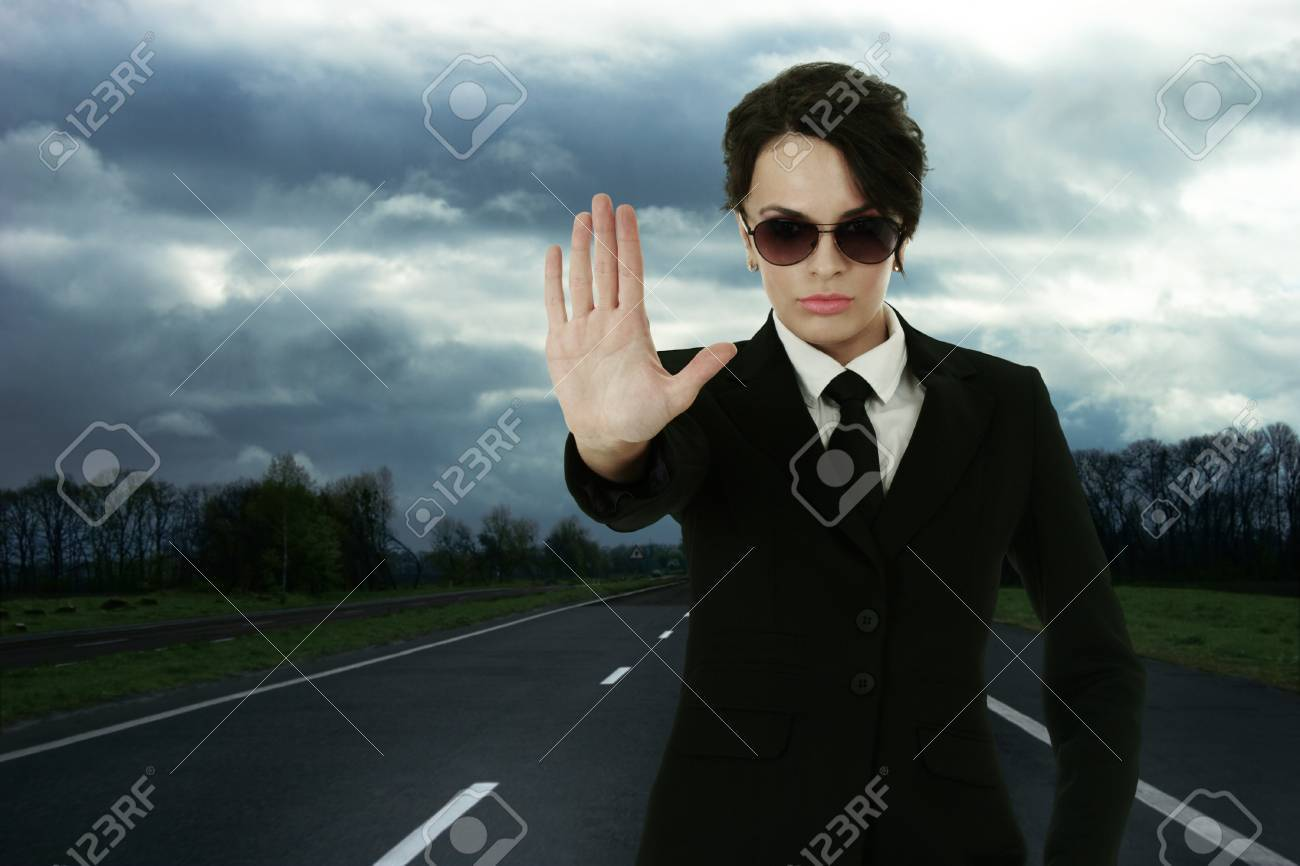 Security service officer stopping traffic on roadway Stock Photo - 8926132
