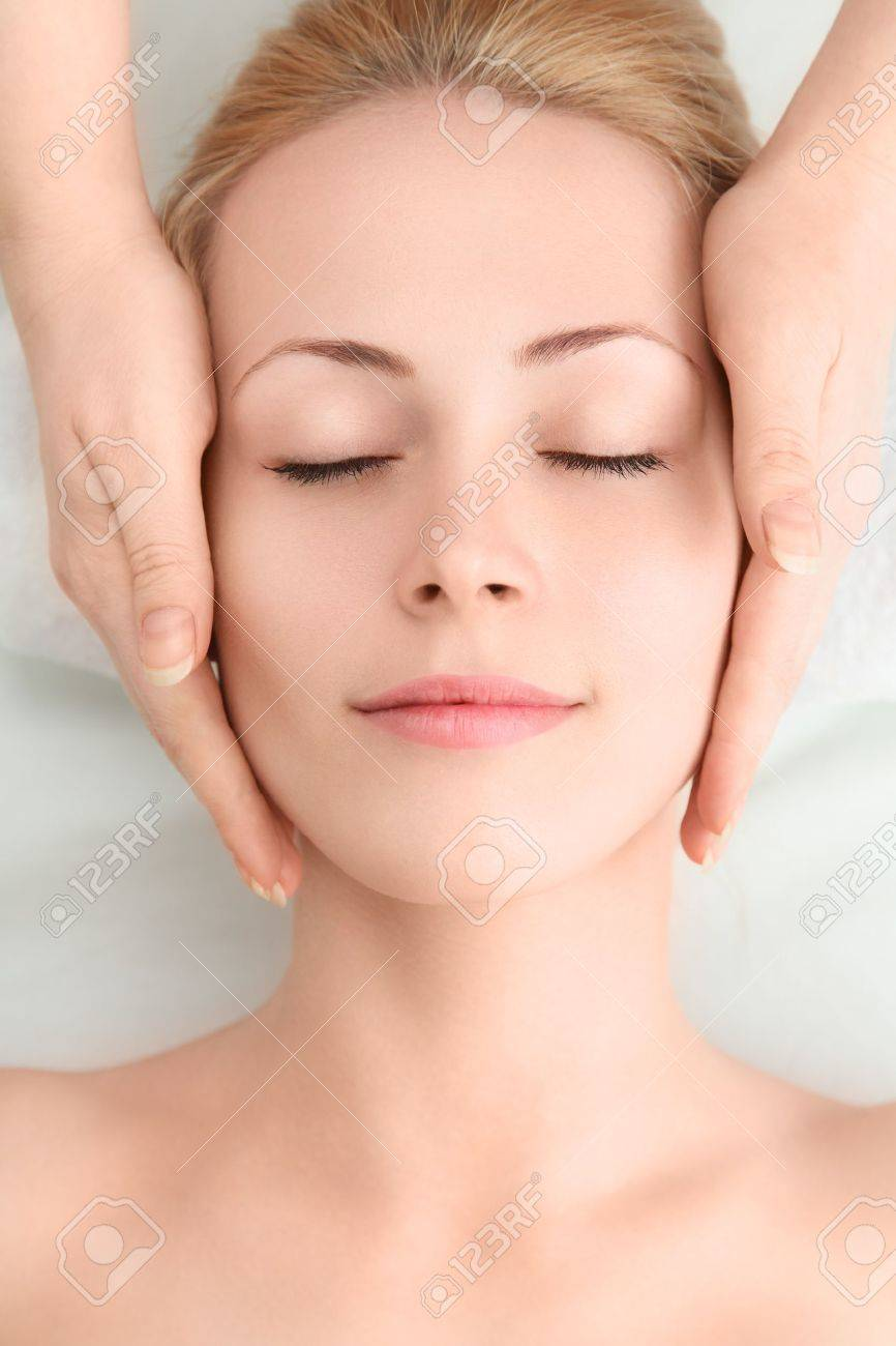 Young sexy woman in spa gets a facial massage Stock Photo - 12774525