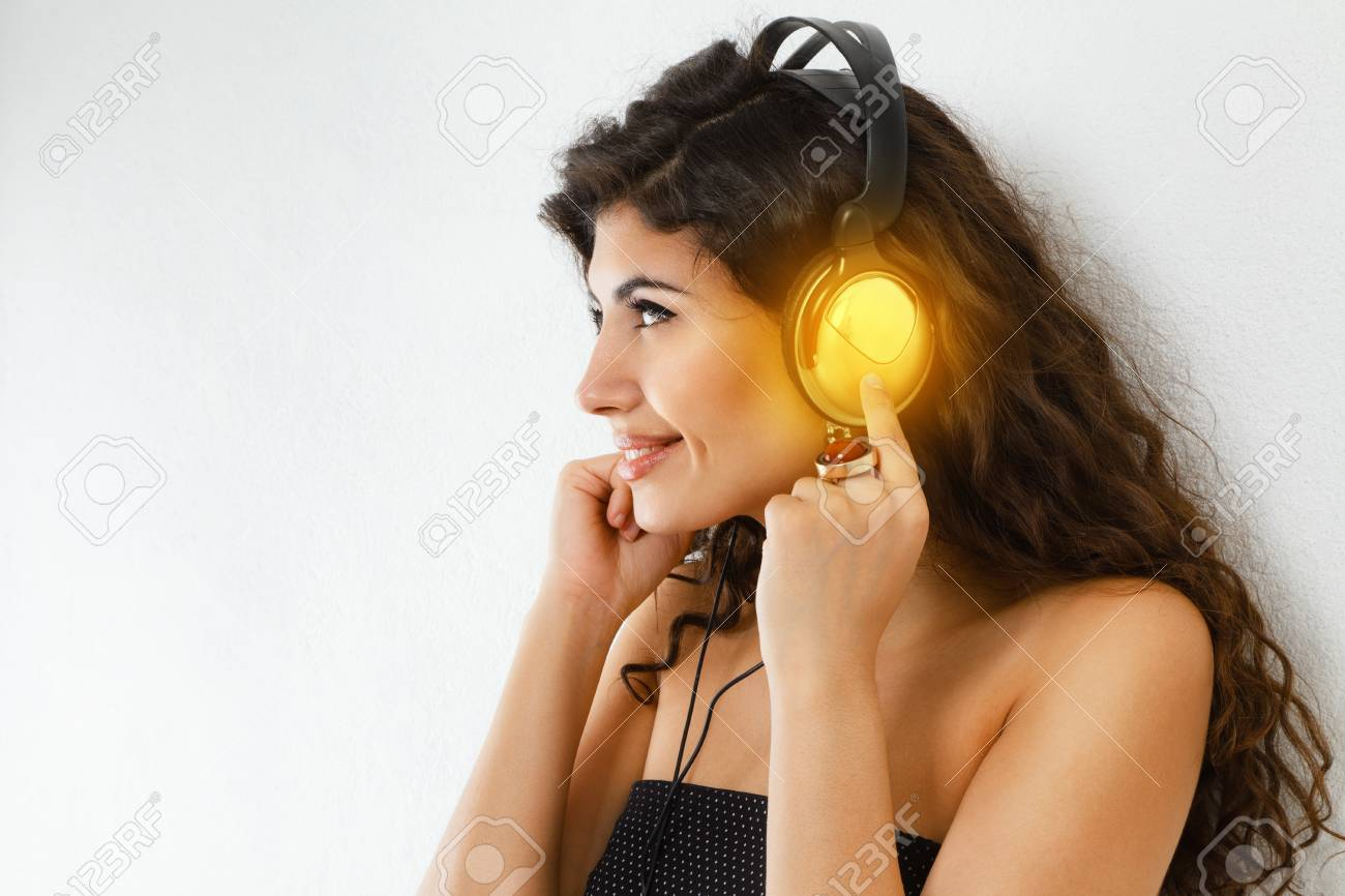 Young Smiling Woman With Headphone Listening To Music Stock Photo