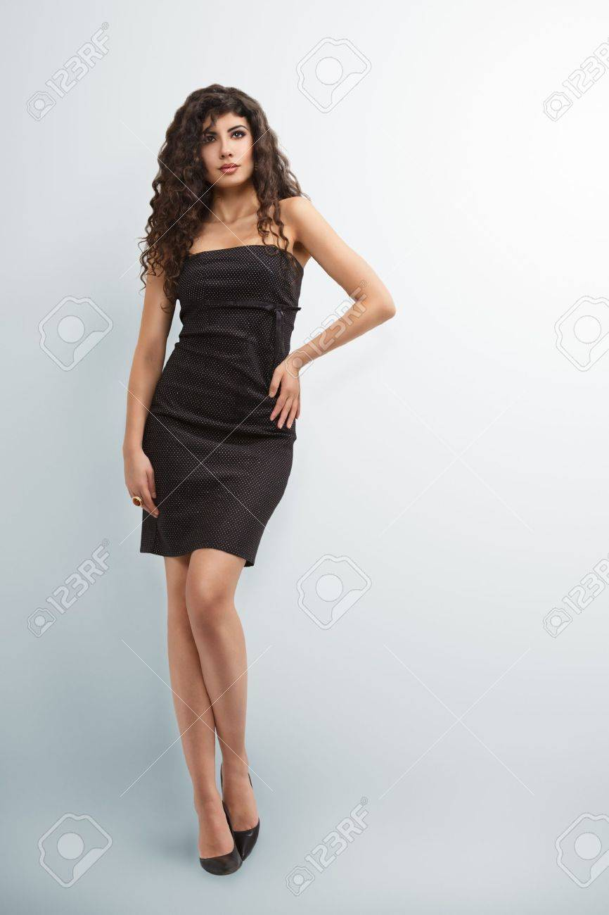 Elegant woman in little black dress with long curly hair Stock Photo -  18655296 b938618b440c