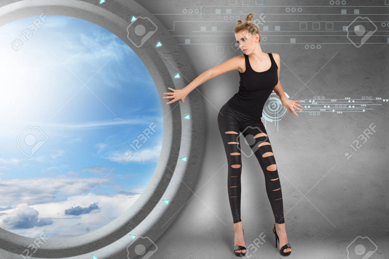 Young woman in futuristic interior playing science fiction crime scene Stock Photo - 18655287