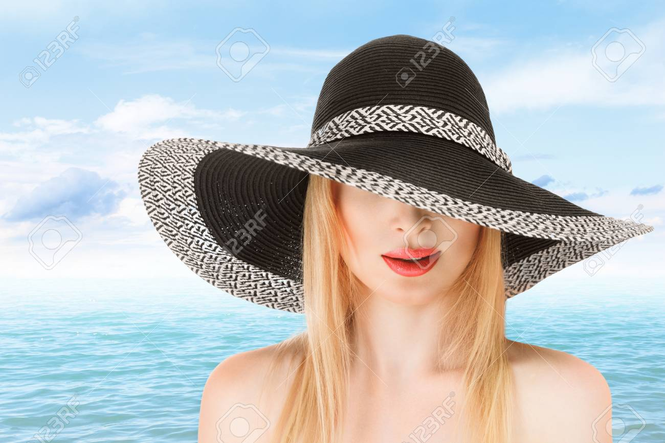 Young woman in sunhat at beach sunny day outdoor Stock Photo - 19355789