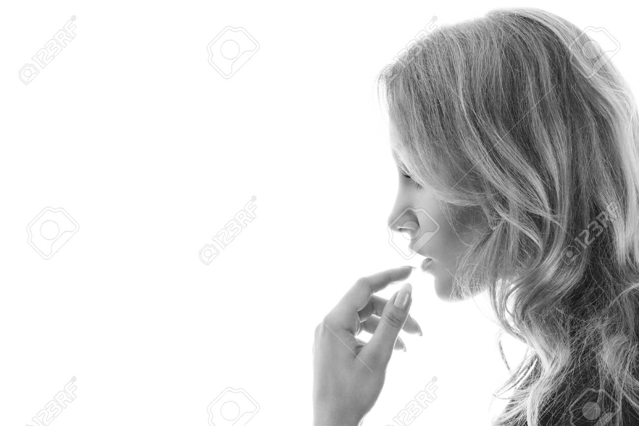 Young blonde woman touching lips close-up portrait isolated on white background Stock Photo - 19355734