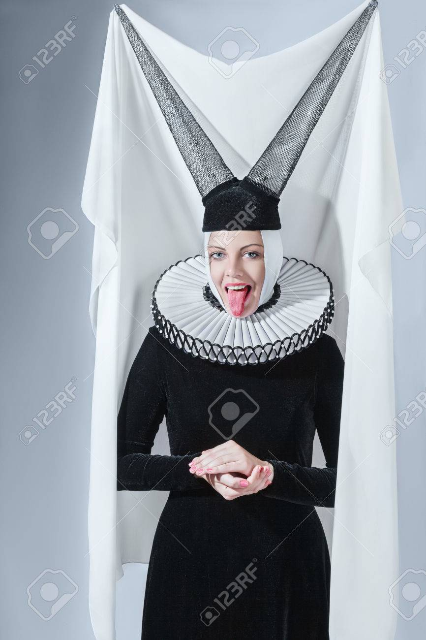 Fashion Woman In A Medieval Gothic Style Clothing Against Studio Background Stock Photo
