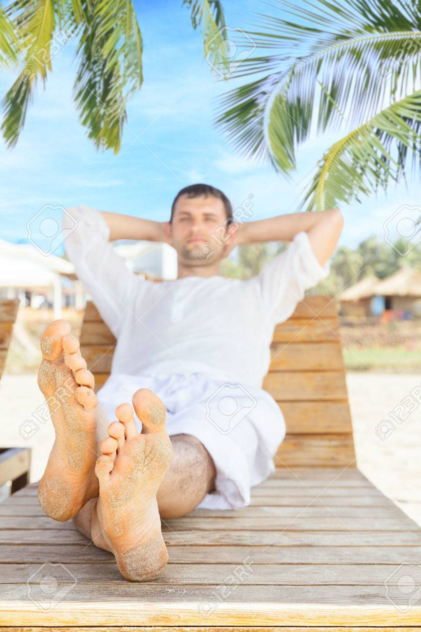 Man Lying Down On Beach Chair And Relaxing In Tropical Resort Stock Photo Picture And Royalty Free Image Image 25060572