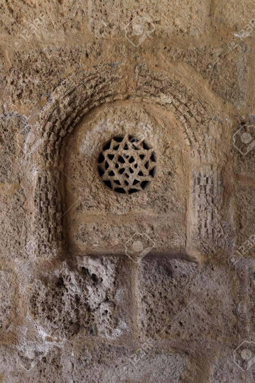 Change rosette in the Romanesque church of San Bartolom?. Campis?balos (Guadalajara, Spain) - 133474657