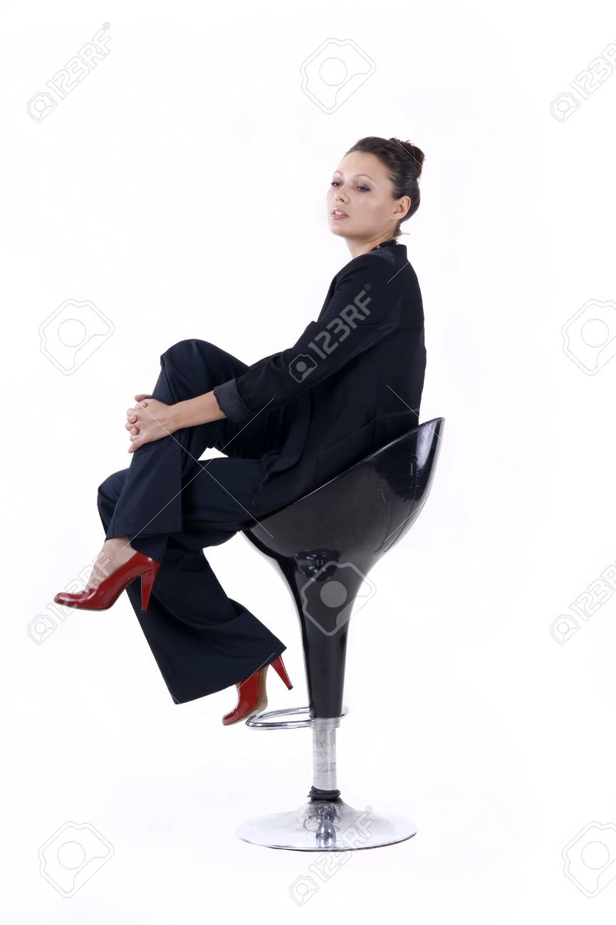 Portrait of a  beautiful girl sits on the bar stool on a white background closeup Stock Photo - 9979341
