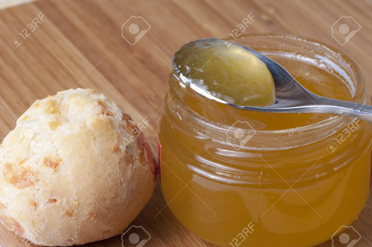 Honey jar and white round bread on the table Stock Photo - 22427712