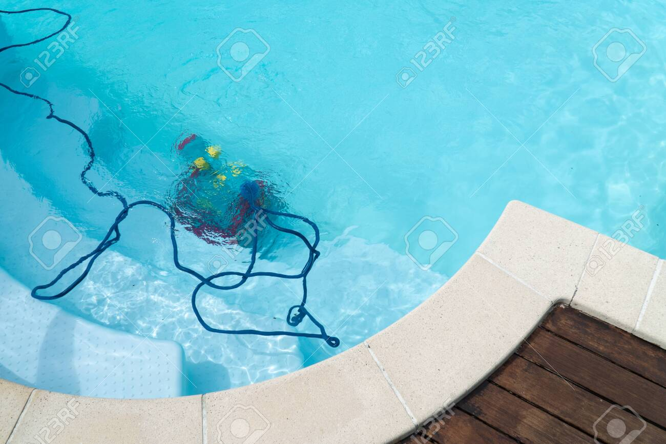 Robot cleaning swimming pool. Maintenance pool concept