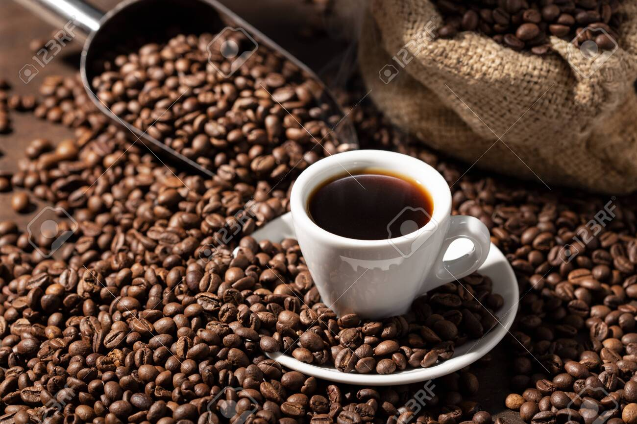 Cup Of espresso Coffee and roasted beans. Coffee background - 146553163