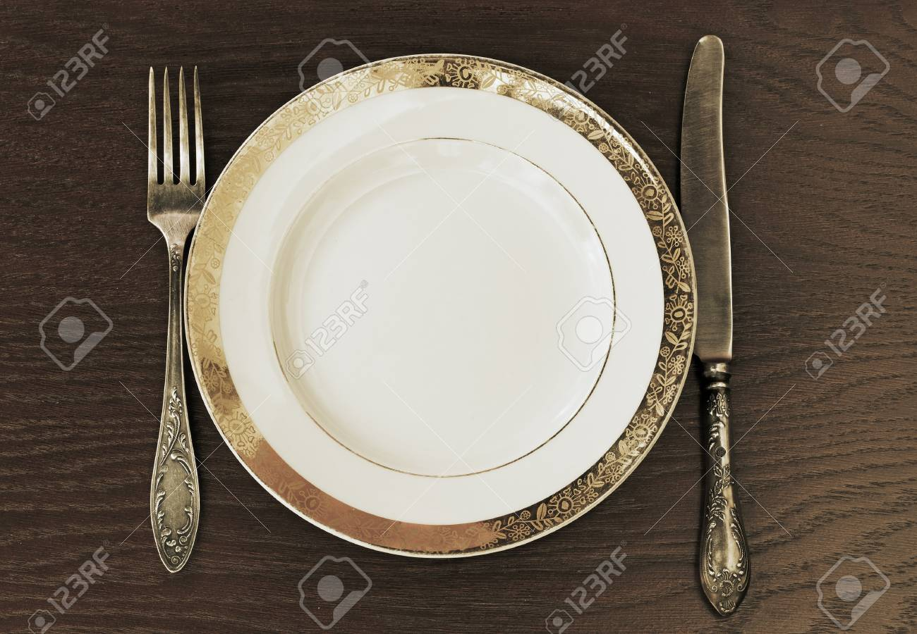 antique fork, knife and plate Stock Photo - 10762225