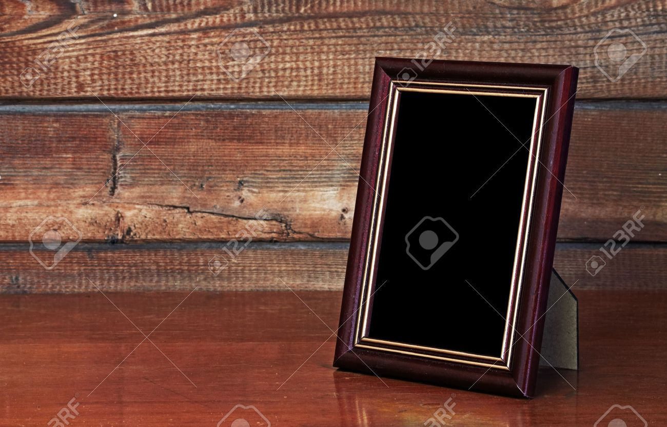 Photo frame on old table stock photo picture and royalty free photo frame on old table stock photo 10783302 jeuxipadfo Image collections