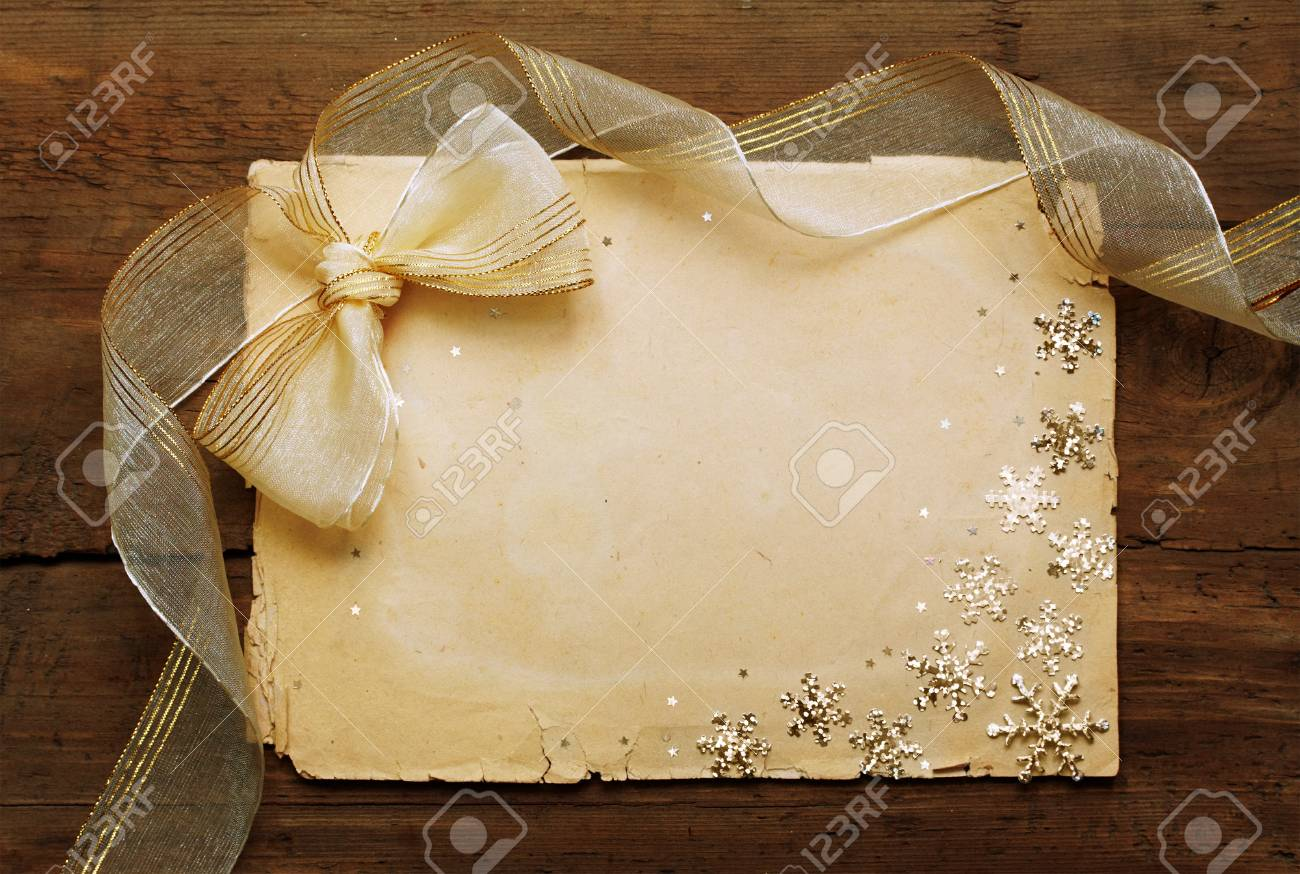 paper on wooden wall, christmas background Stock Photo - 10813240