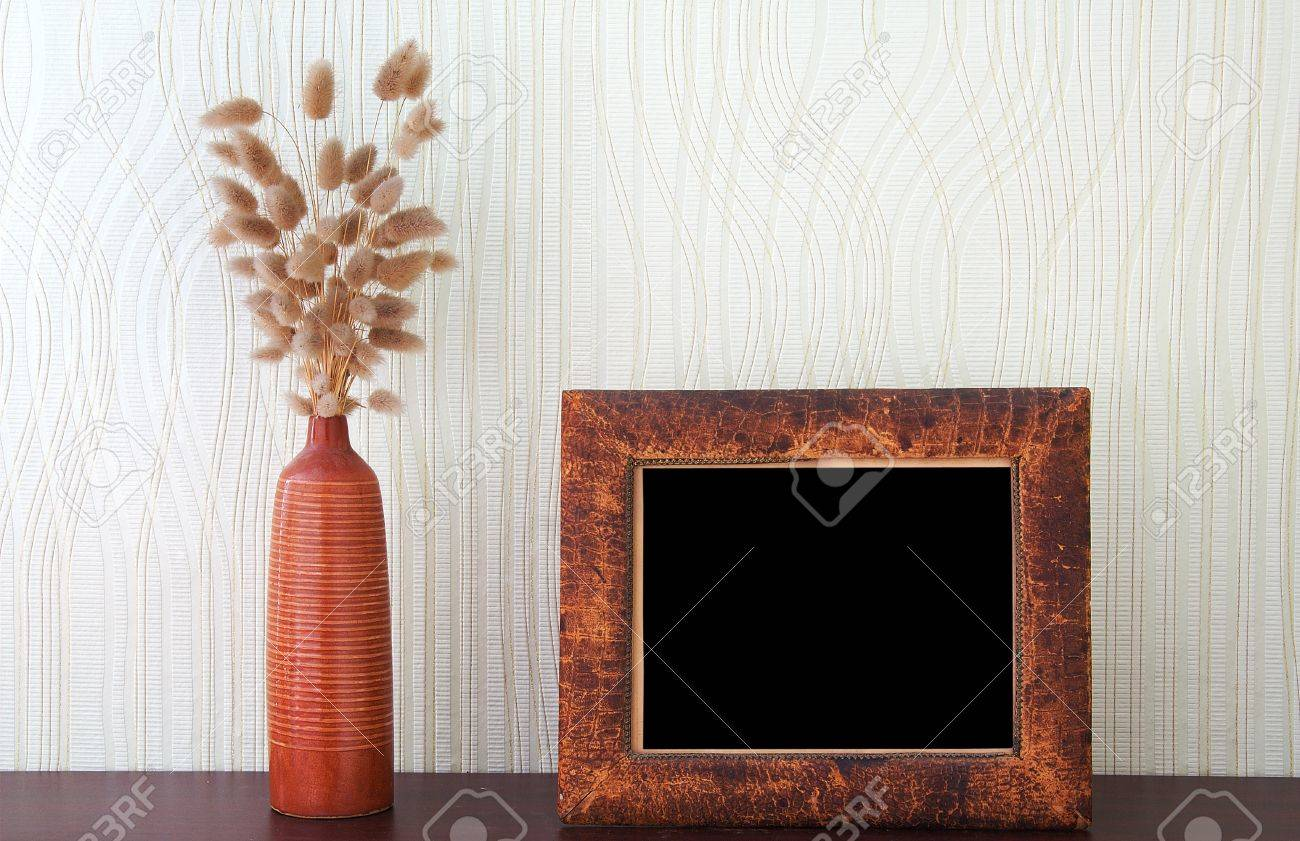 ikebana and vintage photo-frame on table Stock Photo - 13041398