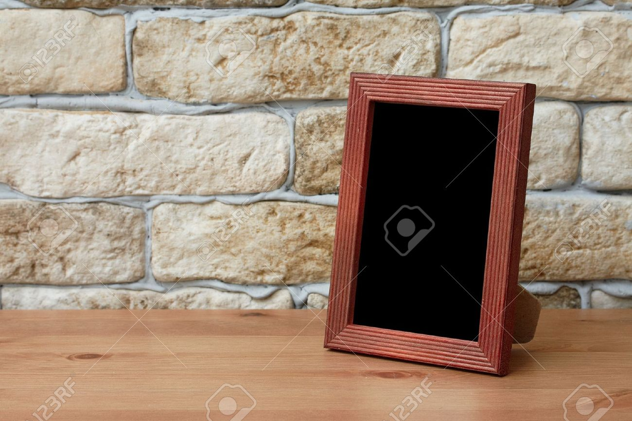 old photo frame on the wooden table Stock Photo - 13296711