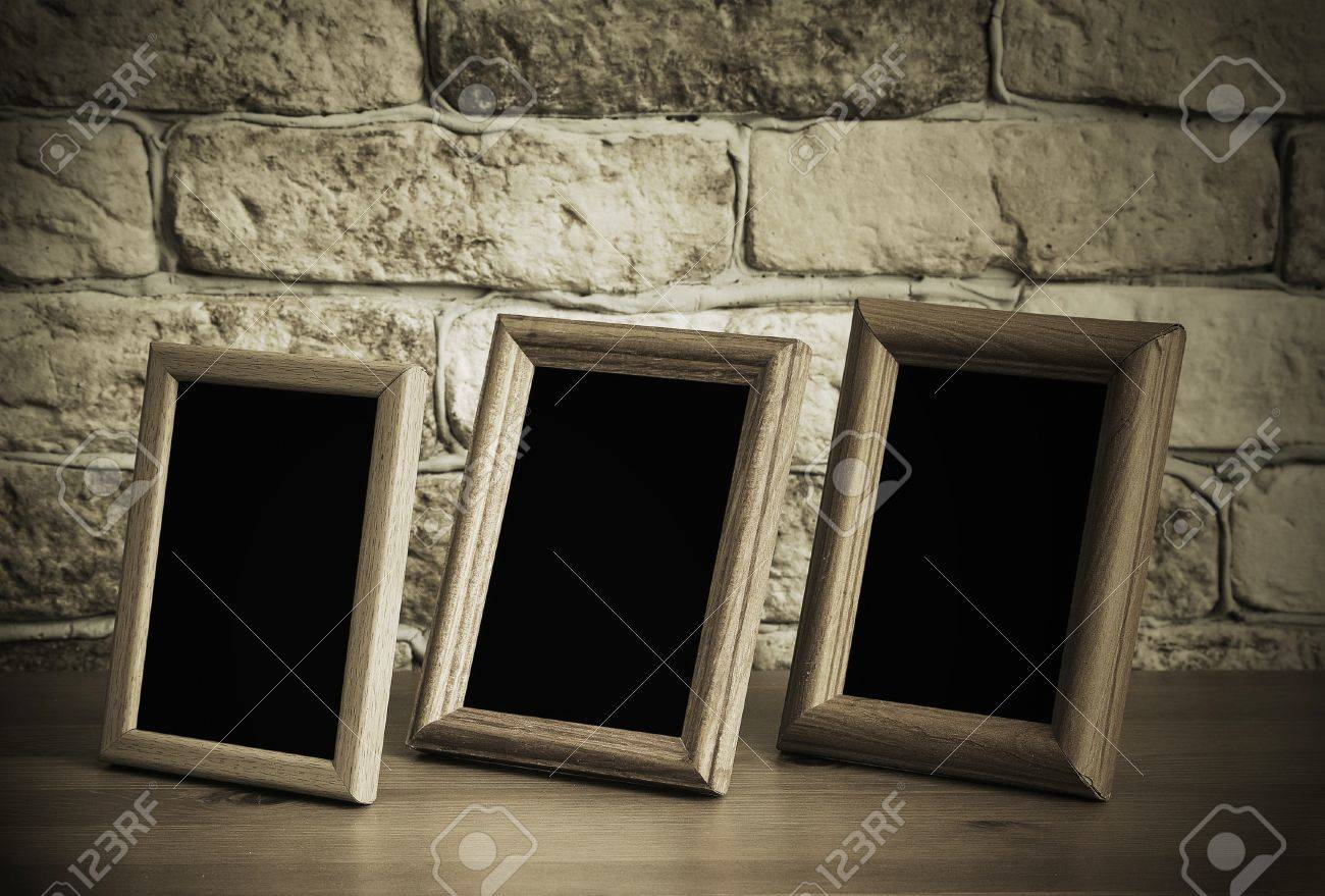old photo frames on the wooden table Stock Photo - 15402405