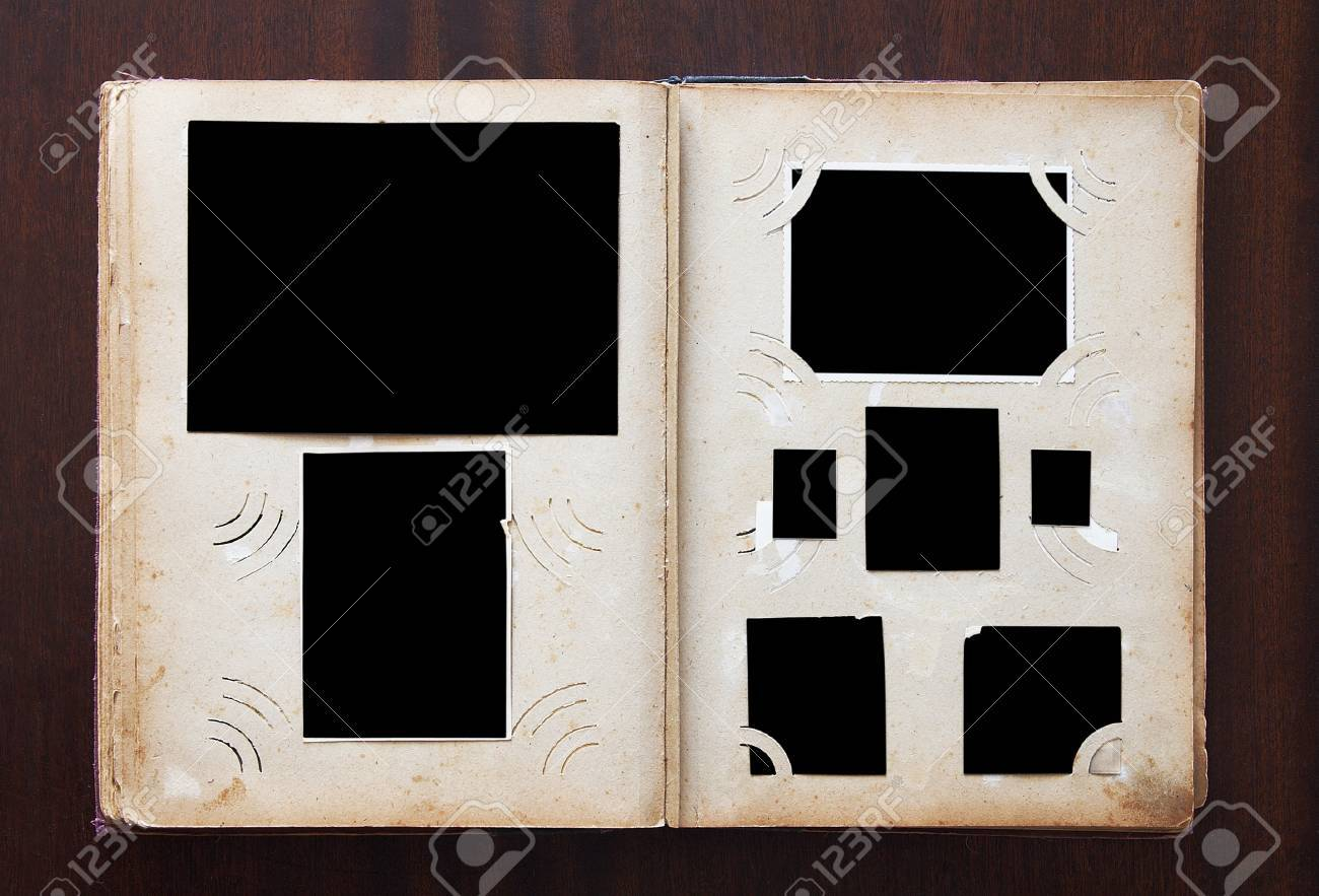 Vintage photo album with blanked photos on old wooden texture Stock Photo - 15437906