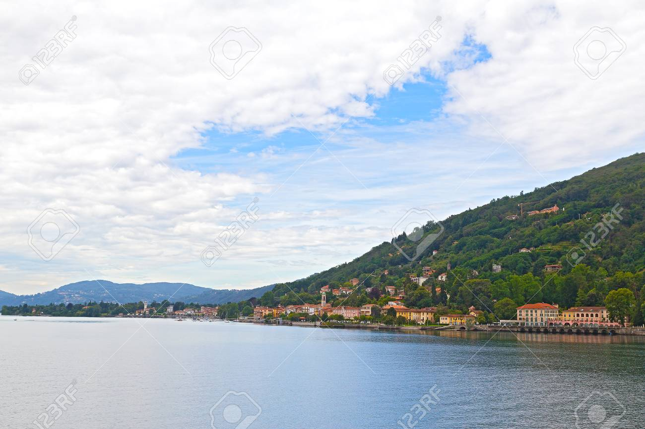 country town on lake como shore in northern italy. panoramic.. stock