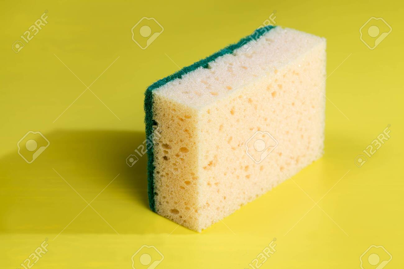 yellow sponge for washing dishes and other items, close-up of kitchen sponges - 148759349