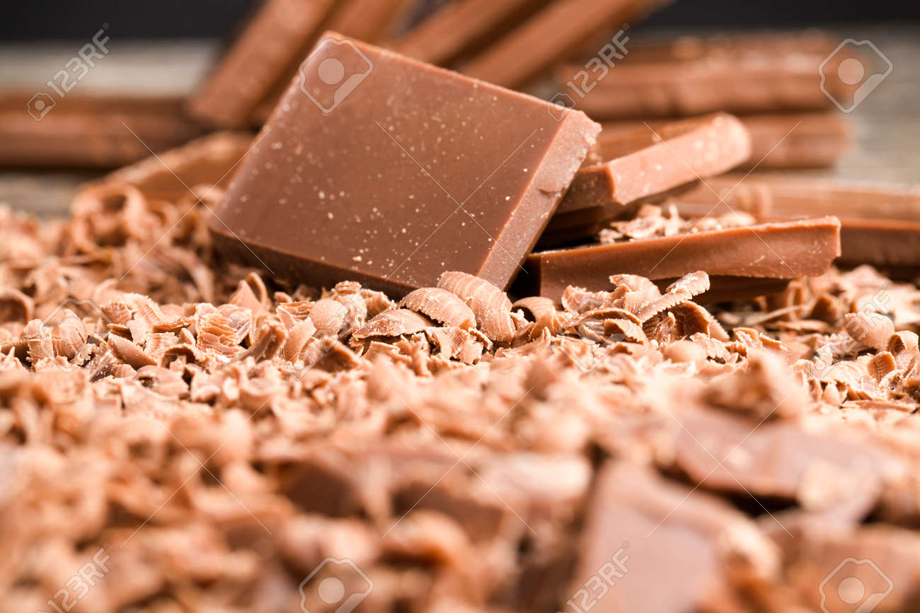 crumbs from delicious chocolate that are used in confectionery production, details and close-up - 172179671