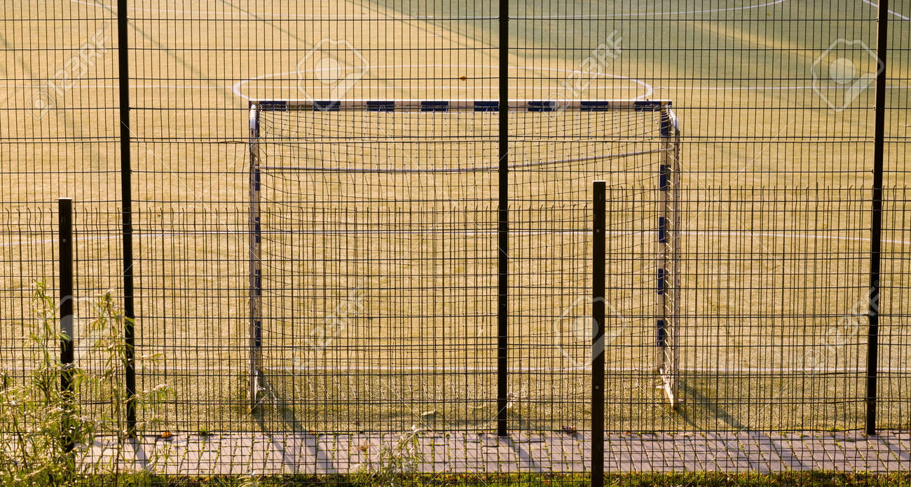 fenced with nets and fences sports grounds for football, close-up of the playing field with a gate - 172179684
