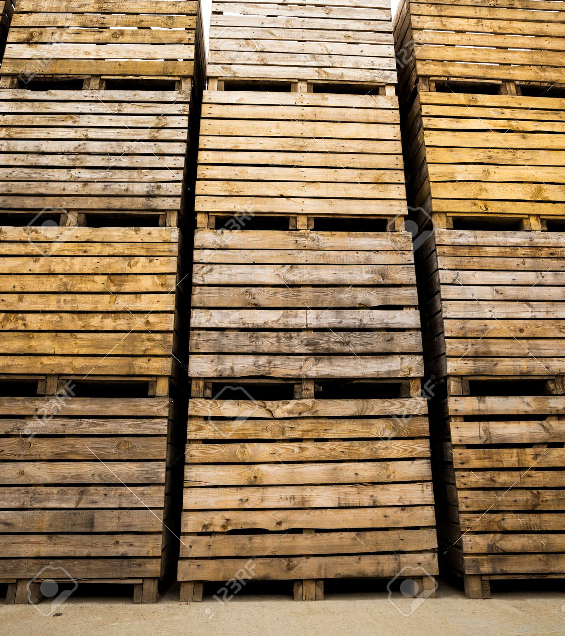 old wooden boxes for storing vegetables and fruit harvest after harvest, storage facilities on the farm, cloudy weather - 172179687