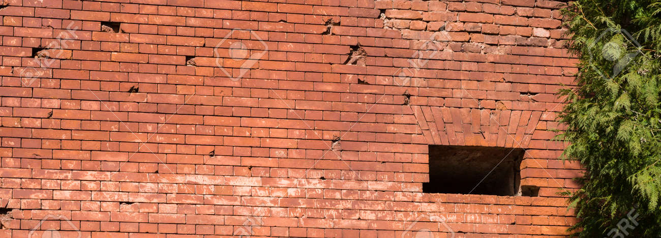 part of the brick wall made in the old castle, close-up of the wall made of a large number of red bricks, old construction abandoned - 172179694