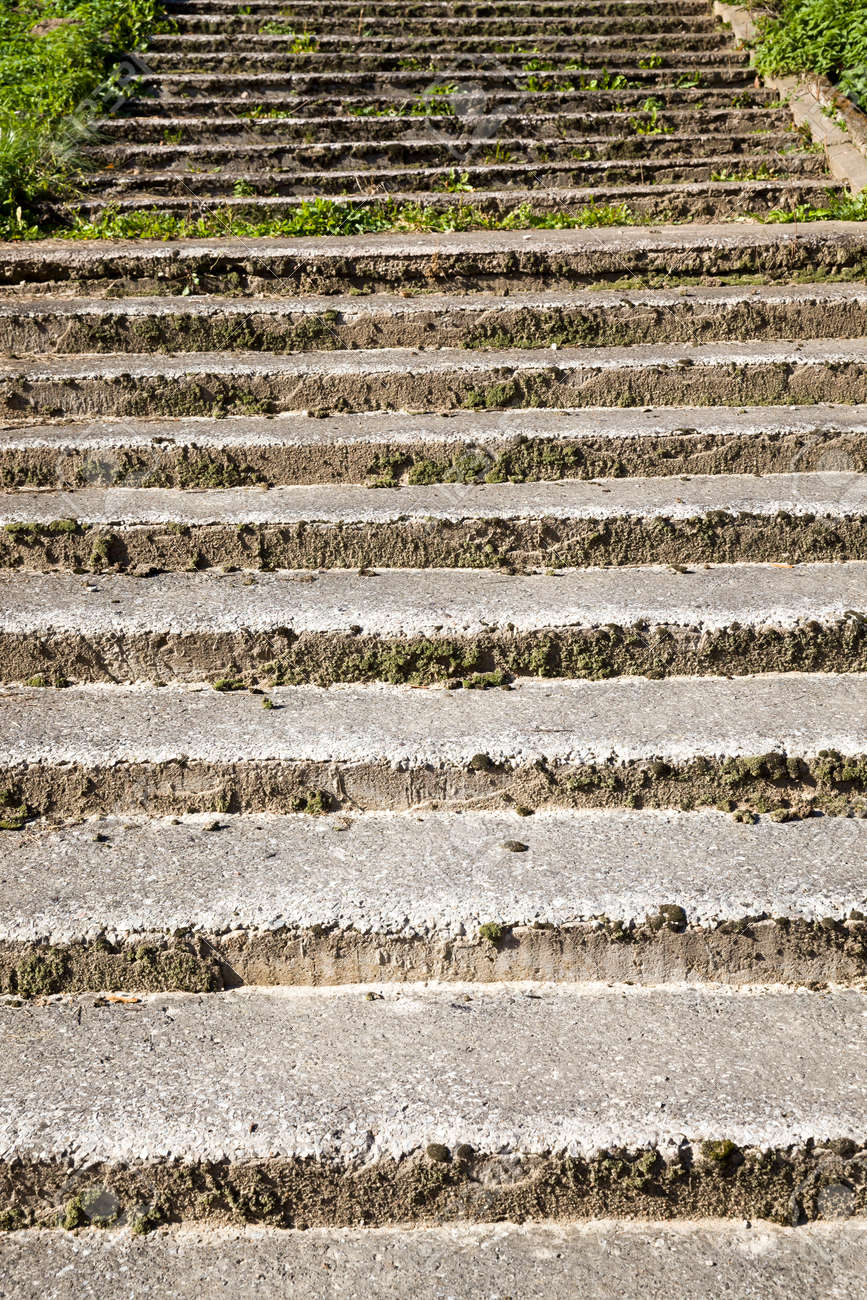 the crumbling old concrete stairs are made of faux concrete and fine aggregate, part and parts of old structures outdoor - 172179709
