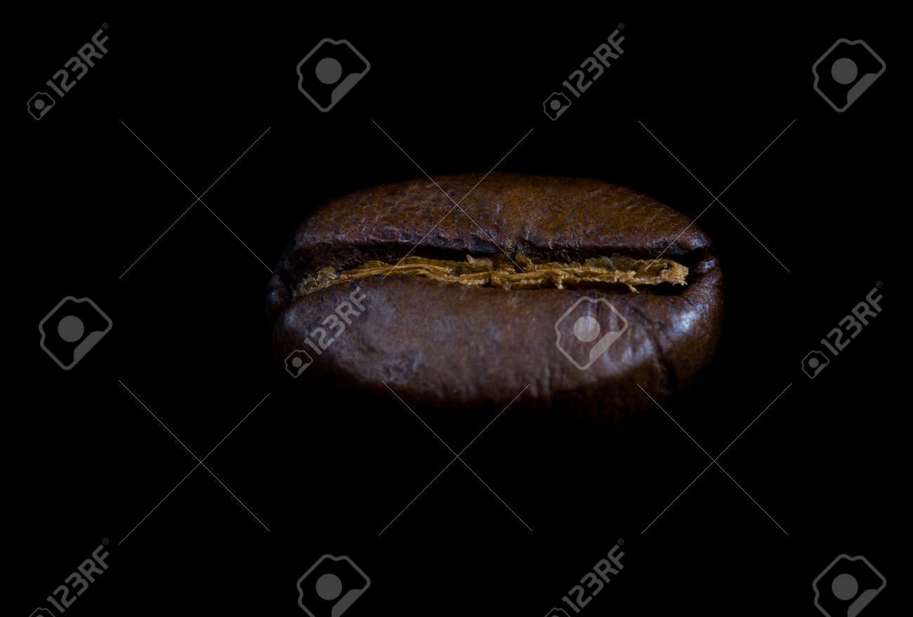 strongly fry one coffee beans on a black background, details of fragrant freshly roasted coffee - 172179717