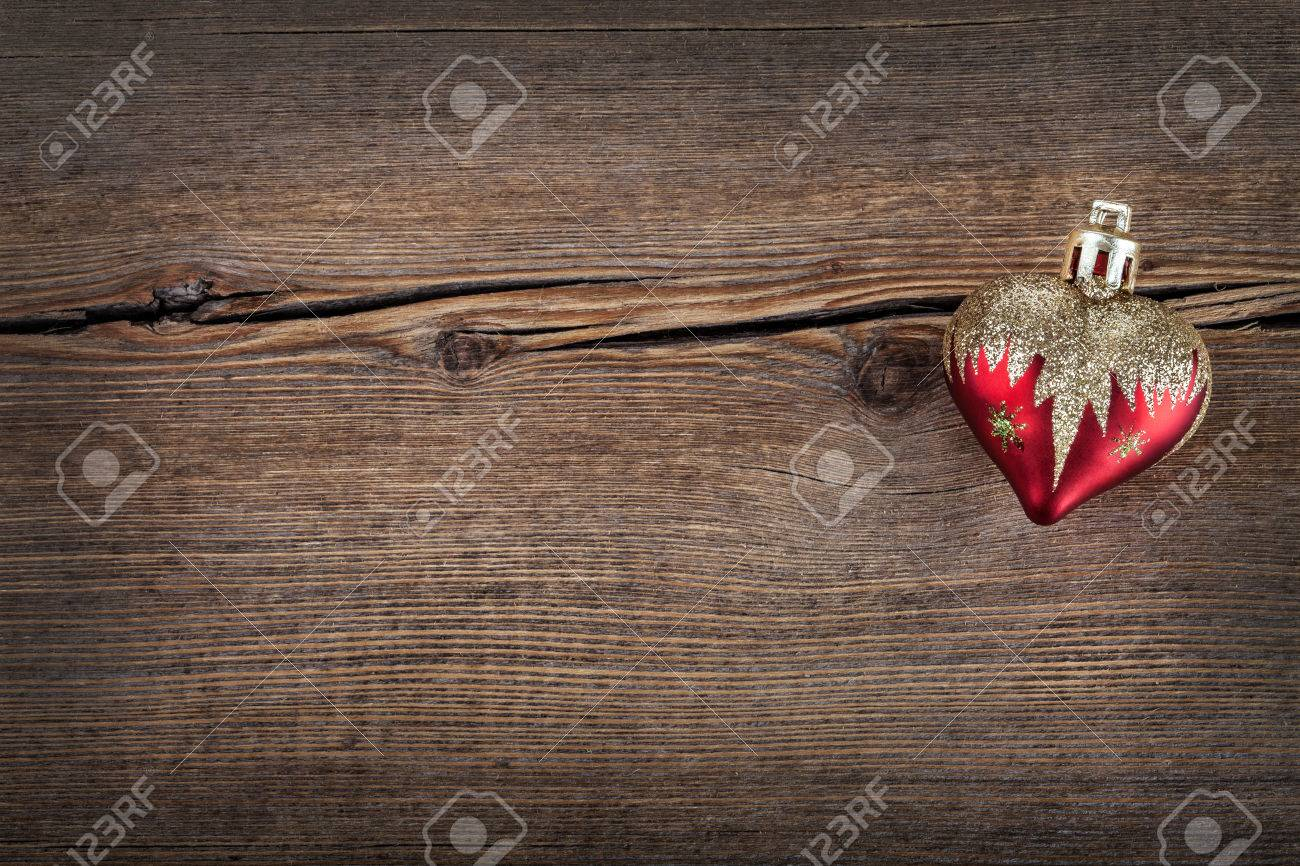 Amazing Wallpaper Christmas Wood - 24601540-christmas-concept-decoration-red-heart-over-rustic-wooden-background-texture-close-up-horizontal-ret  Graphic_515443 .jpg