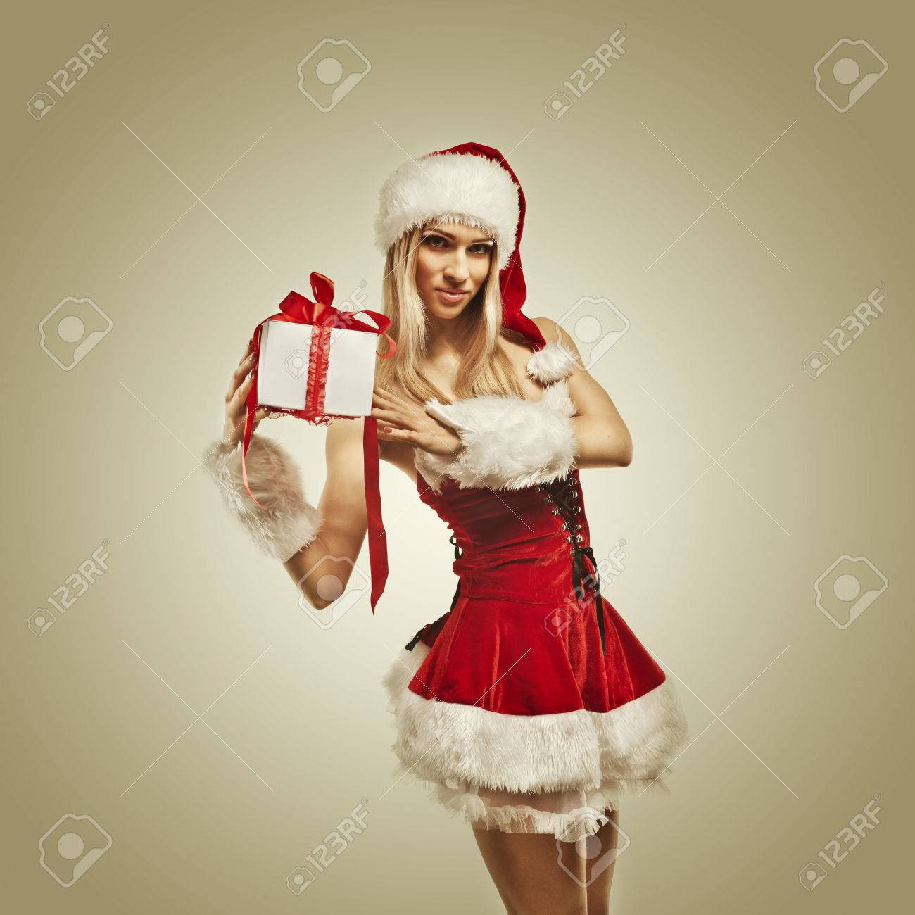Beautiful Woman In Santa Clause Costume With Christmas Gift... Stock ...