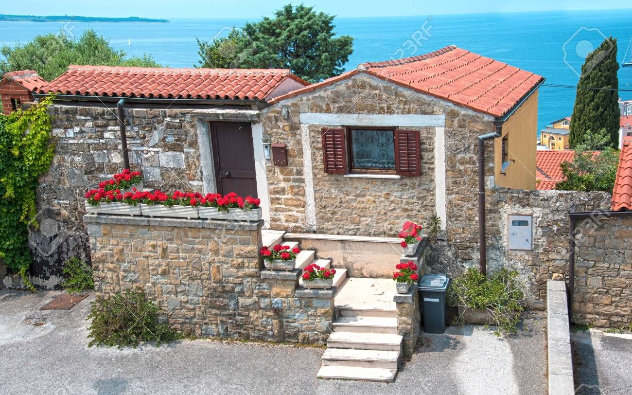 Beautiful landscape with a cozy little house with flowers in porec croatia tourist center stock