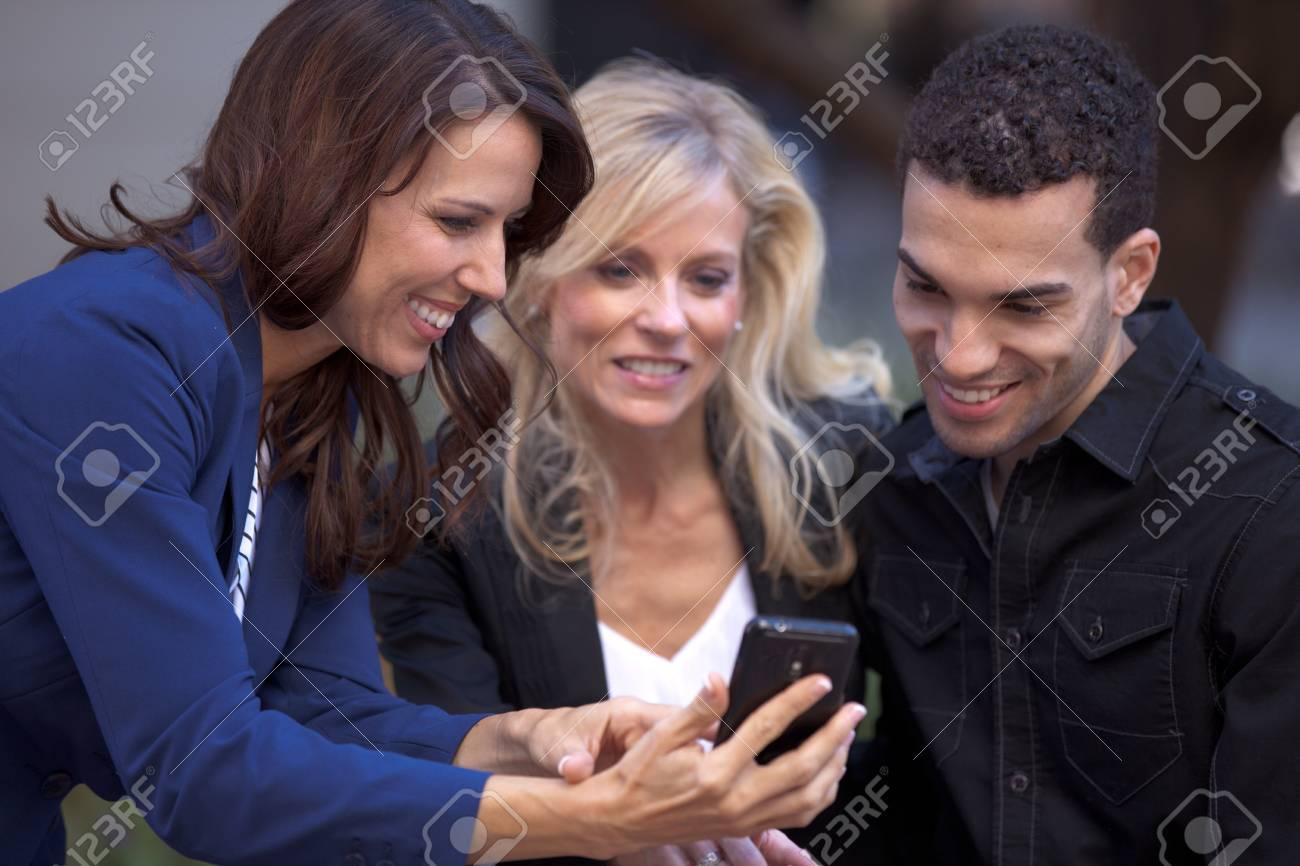 Group of friends smiling looking at a Picture Stock Photo - 13562355