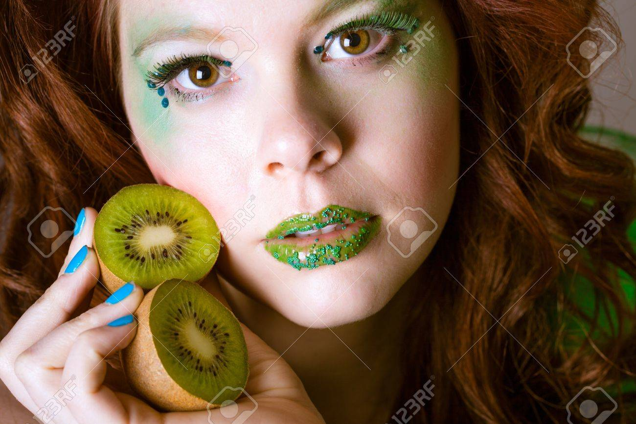 Beautiful Redheaded Woman With Green Highlighted Makeup For St