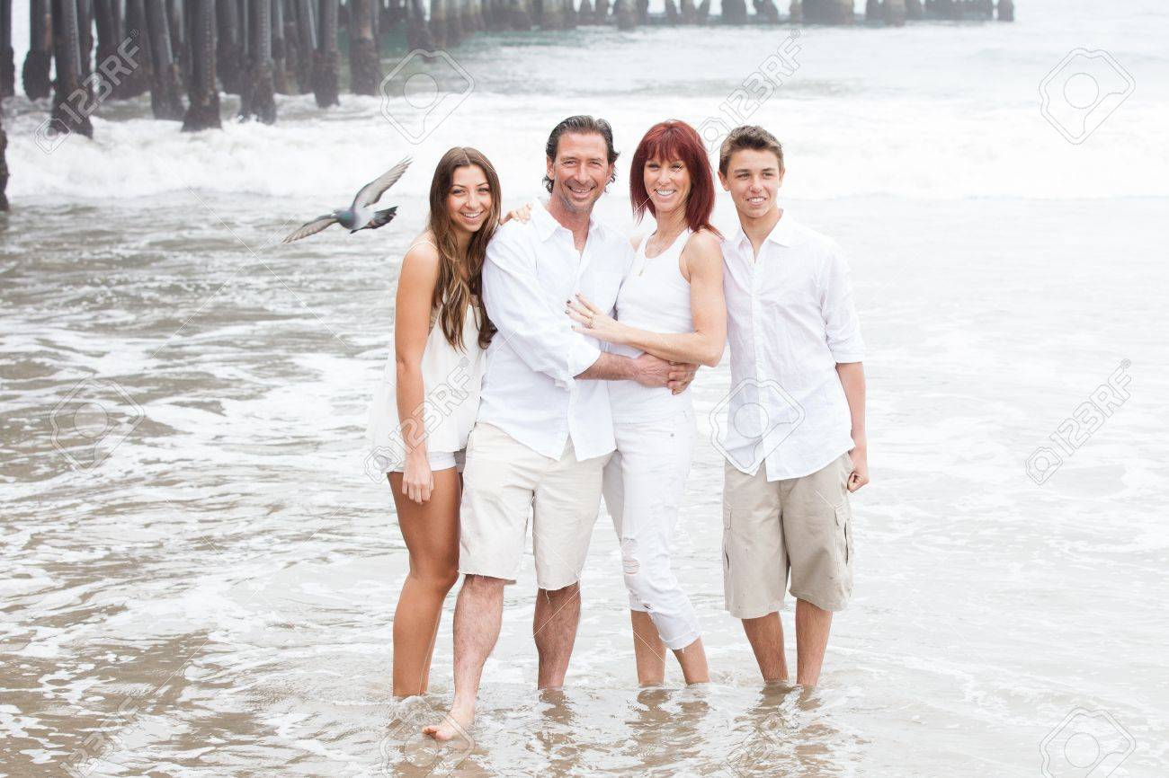 Attractive Family posing for a portrait by the Santa Monica pier in California while on vacation Stock Photo - 18259134