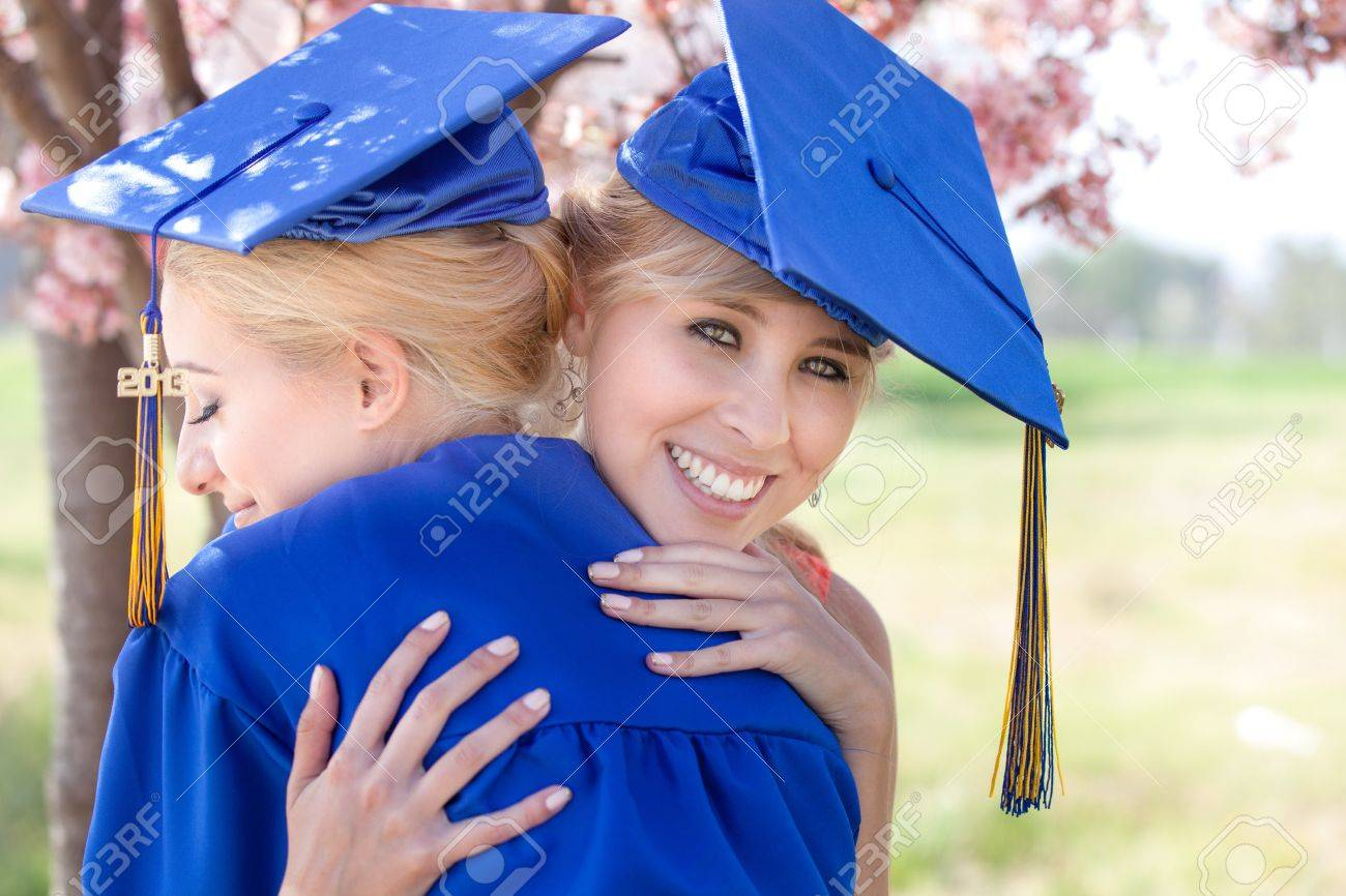 Beautiful Blonde Women In Blue Gowns Embracing Celebrating Their ...