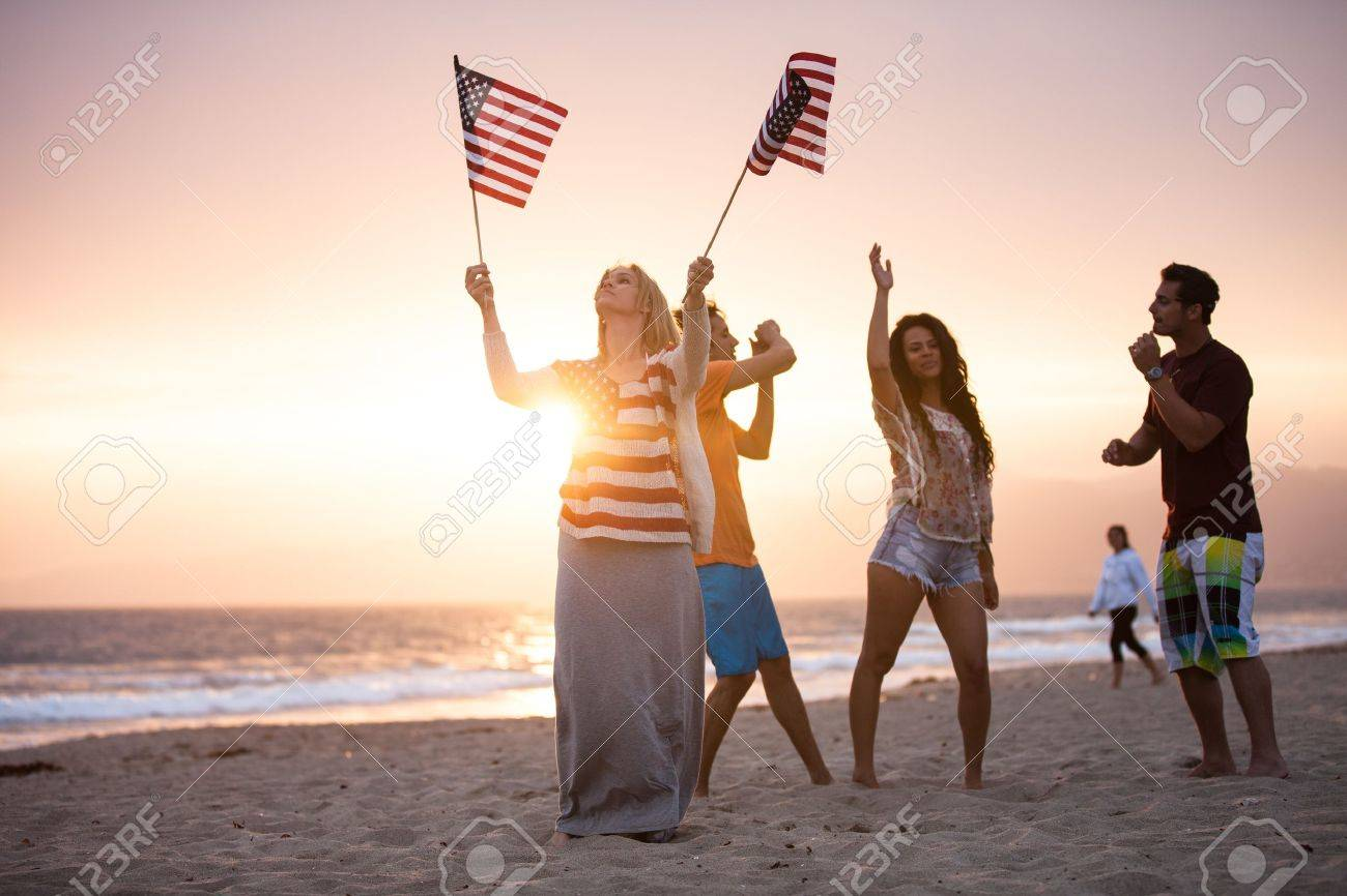 Group of Friends in their twenties dancing on the Beach at Sunsrt on 4th of July Stock Photo - 19944079